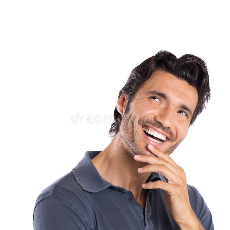 Jeune homme contemplé heureux photographie stock