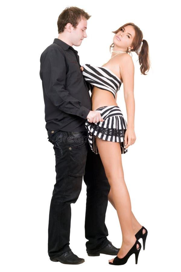 Jeune homme déshabillant le joli femme photo stock