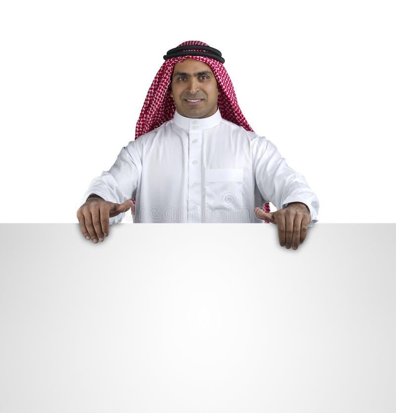 Jeune homme d'affaires arabe de sourire heureux affichant le blanc images libres de droits