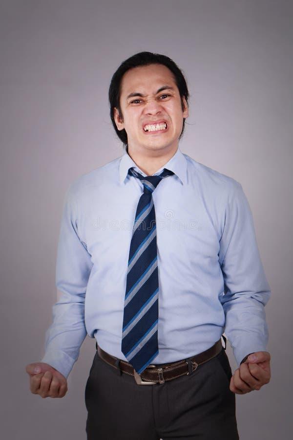 Jeune homme d'affaires asiatique Angry Expression image libre de droits