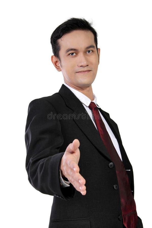 Jeune homme d'affaires asiatique donnant la poignée de main, d'isolement sur le blanc image libre de droits