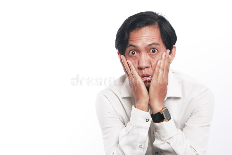 Jeune homme d'affaires asiatique drôle Looked Very Bored photographie stock libre de droits