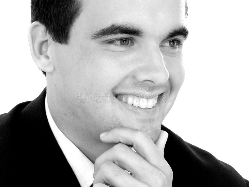 Jeune homme d'affaires attirant dans le sourire de procès photo stock