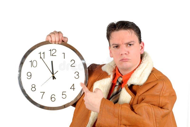 Jeune homme d'affaires avec l'horloge photos stock