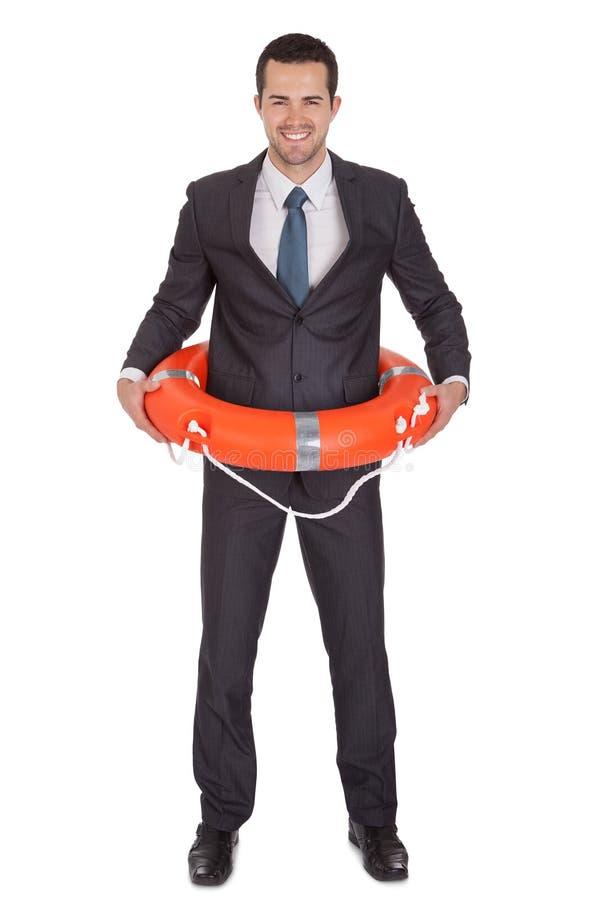 Jeune homme d'affaires avec la bouée de durée photo libre de droits