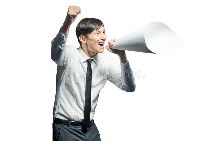 Jeune homme d'affaires criant avec un mégaphone de papiers photos libres de droits