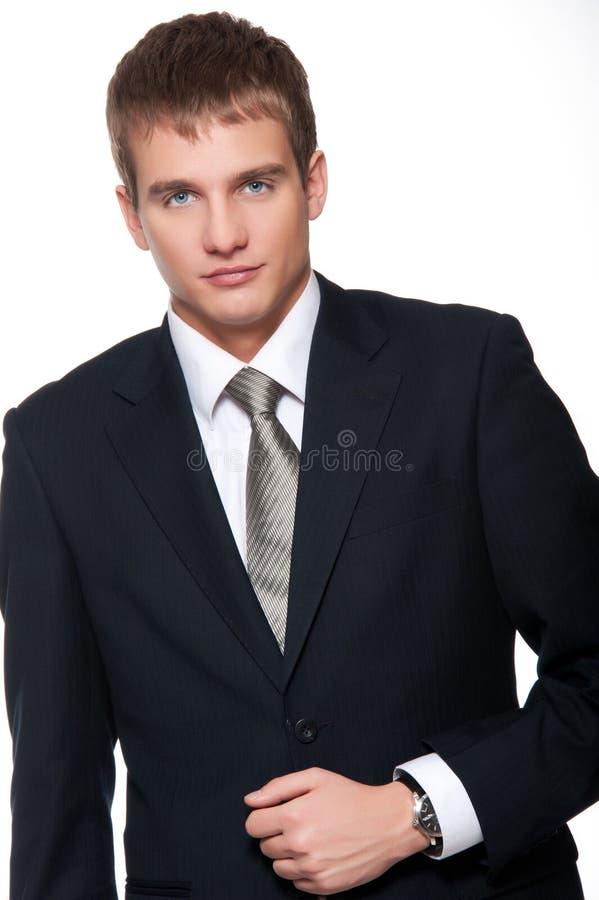 Jeune homme d'affaires d'isolement sur le blanc. images stock