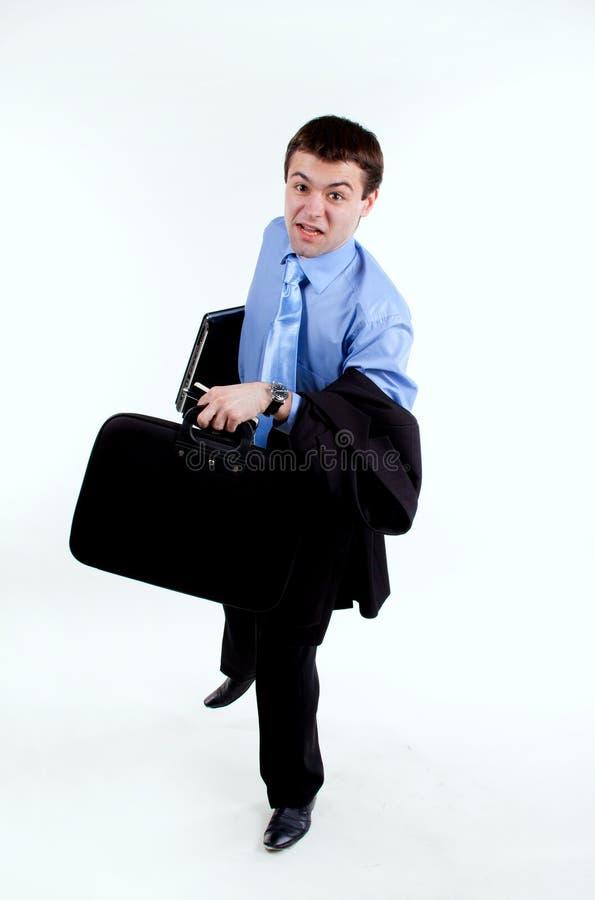Jeune homme d'affaires dans l'exécution photos stock
