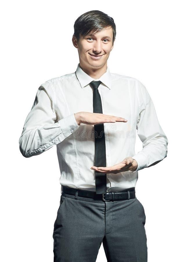Jeune homme d'affaires de sourire tenant quelque chose image libre de droits