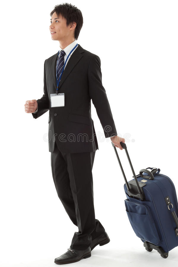 Jeune homme d'affaires en voyage d'affaires images stock