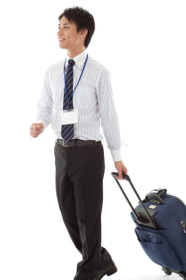 Jeune homme d'affaires en voyage d'affaires photo stock