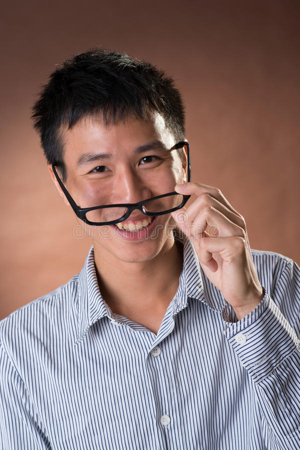 Jeune homme d'affaires franc chinois photo stock