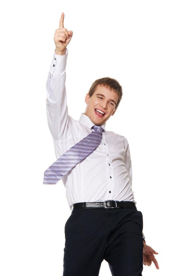 Jeune homme d'affaires heureux d'isolement sur le blanc photographie stock