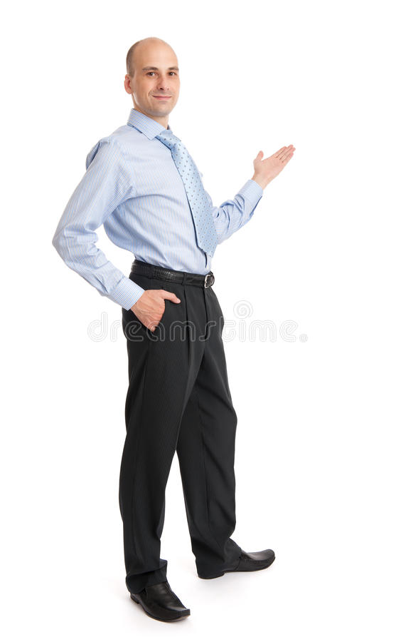 Jeune homme d'affaires heureux Presenting images stock