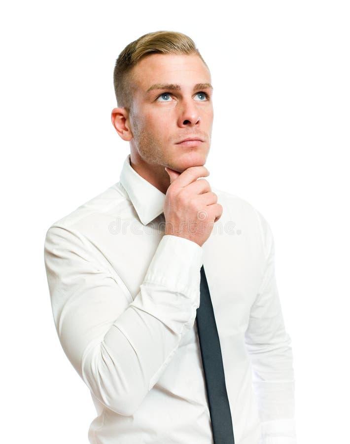 Jeune homme d'affaires pensif. images libres de droits