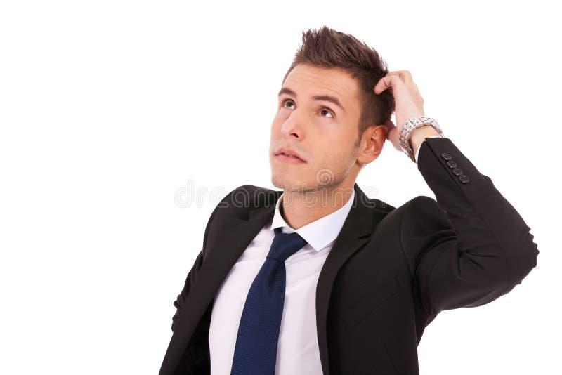 Jeune homme d'affaires pensif image stock