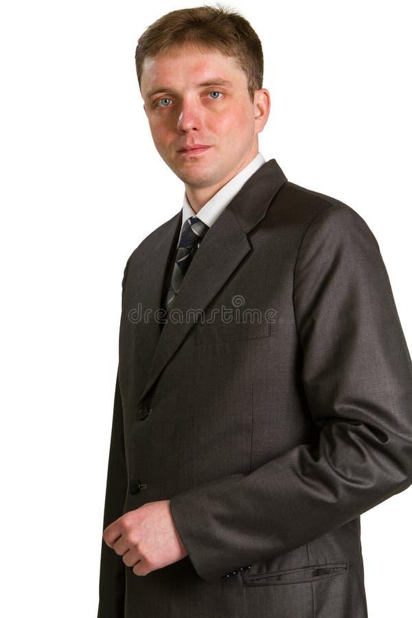 Jeune homme d'affaires posant dans un procès image libre de droits