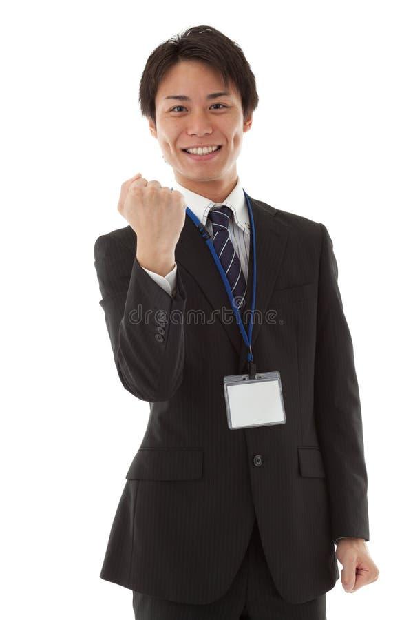 Jeune homme d'affaires posant des entrailles photos stock