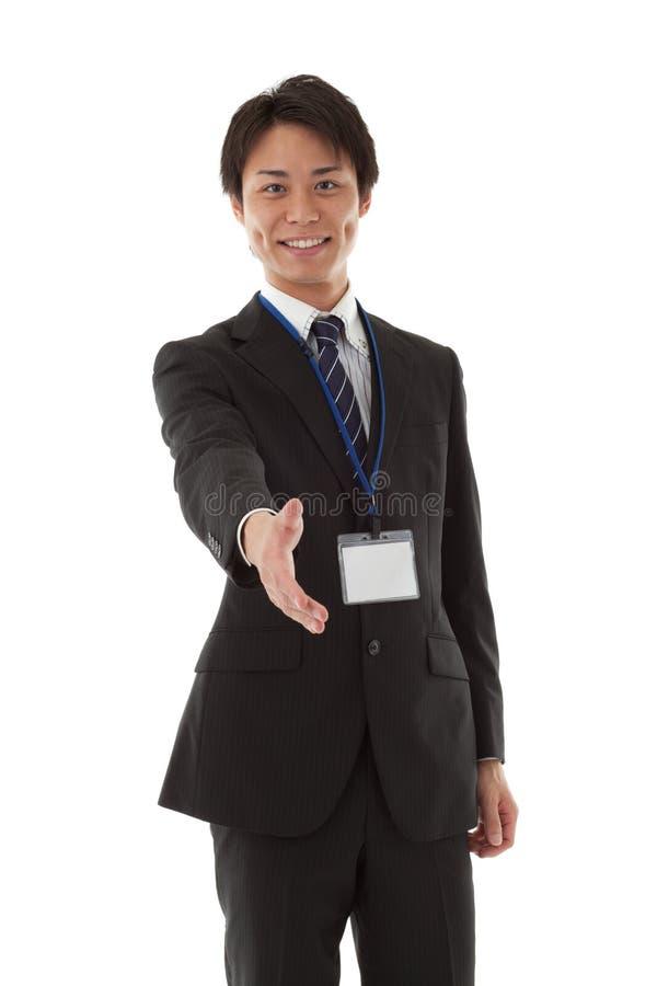 Jeune homme d'affaires pour une prise de contact images stock