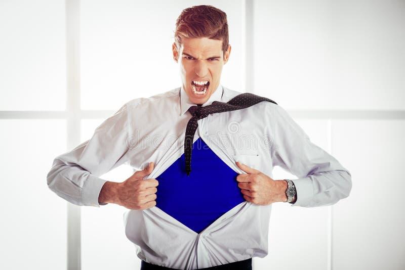Jeune homme d'affaires - super héros images stock