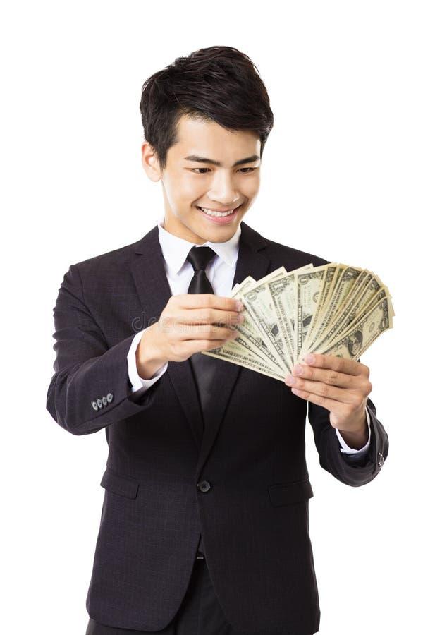jeune homme d'affaires tenant l'argent photos libres de droits