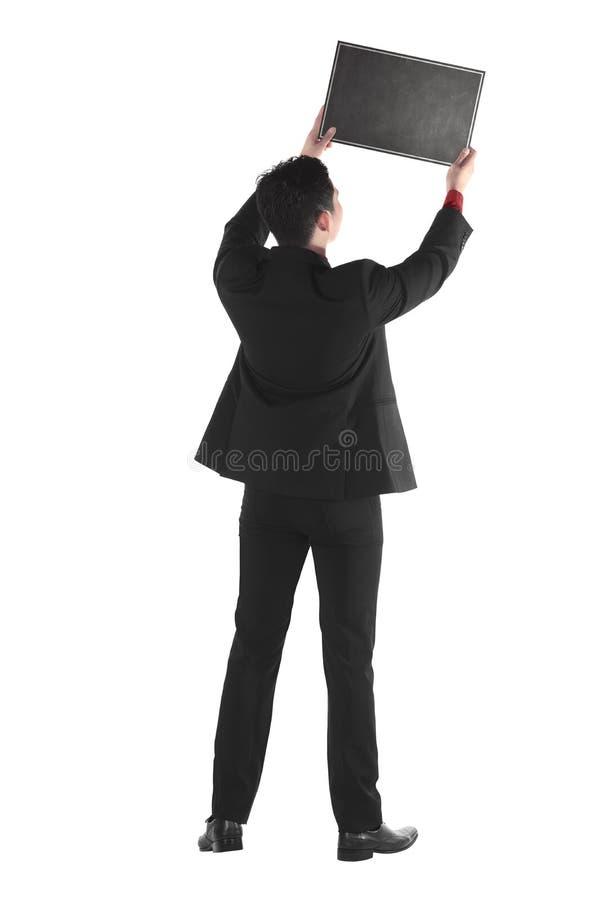 Jeune homme d'affaires tenant le panneau de craie images libres de droits