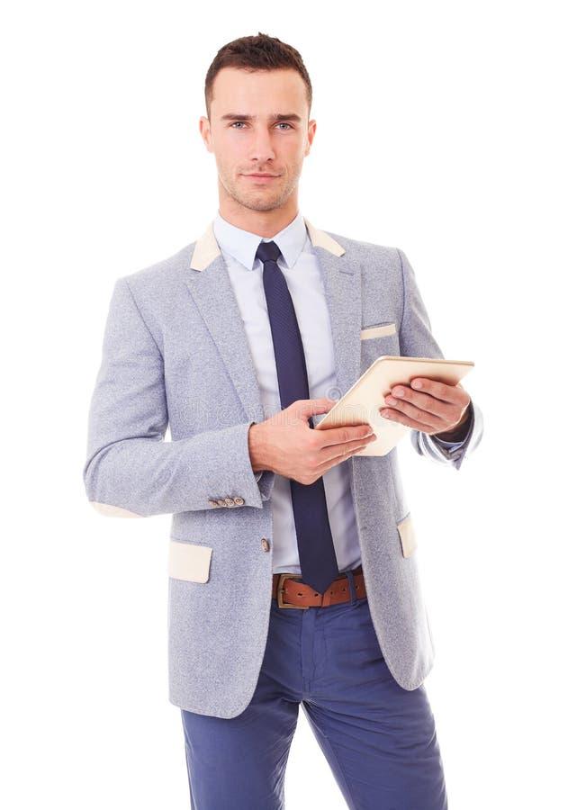 Jeune homme d'affaires utilisant l'ordinateur de tablette photo libre de droits