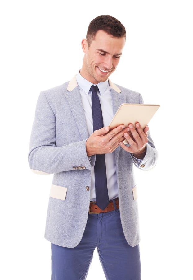 Jeune homme d'affaires utilisant le PC de comprimé photographie stock