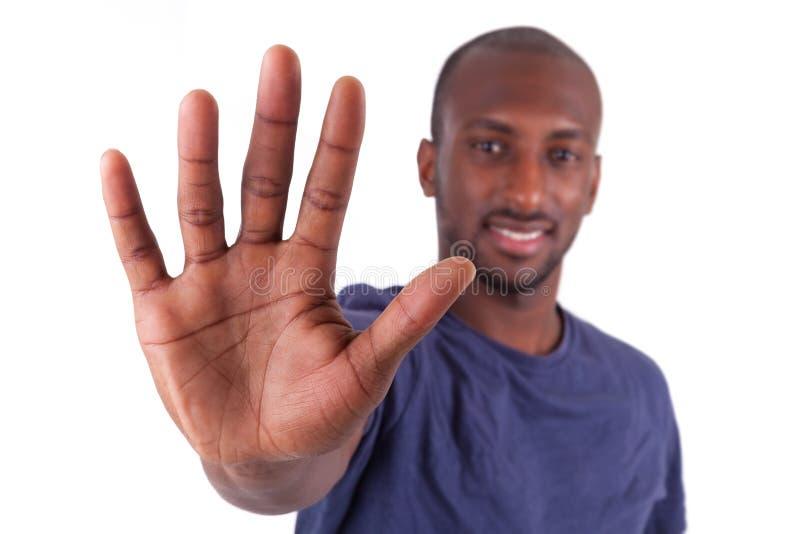 Jeune homme d'Afro-américain sa paume de mains photo libre de droits