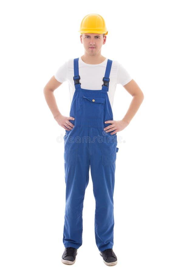 Jeune homme dans l'uniforme bleu de constructeur d'isolement sur le blanc photos libres de droits
