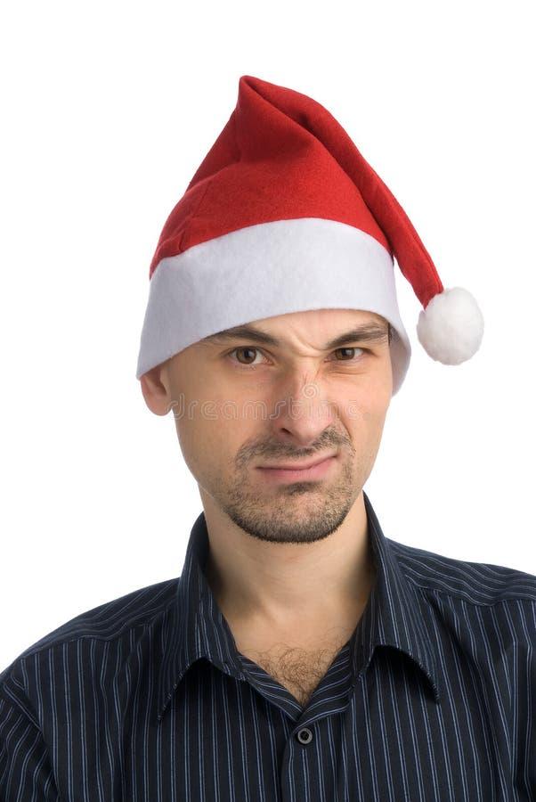 Jeune homme dans un chapeau de Santa photo stock