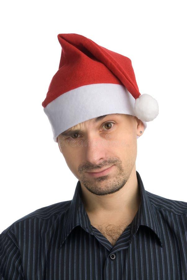 Jeune homme dans un chapeau de Santa image libre de droits