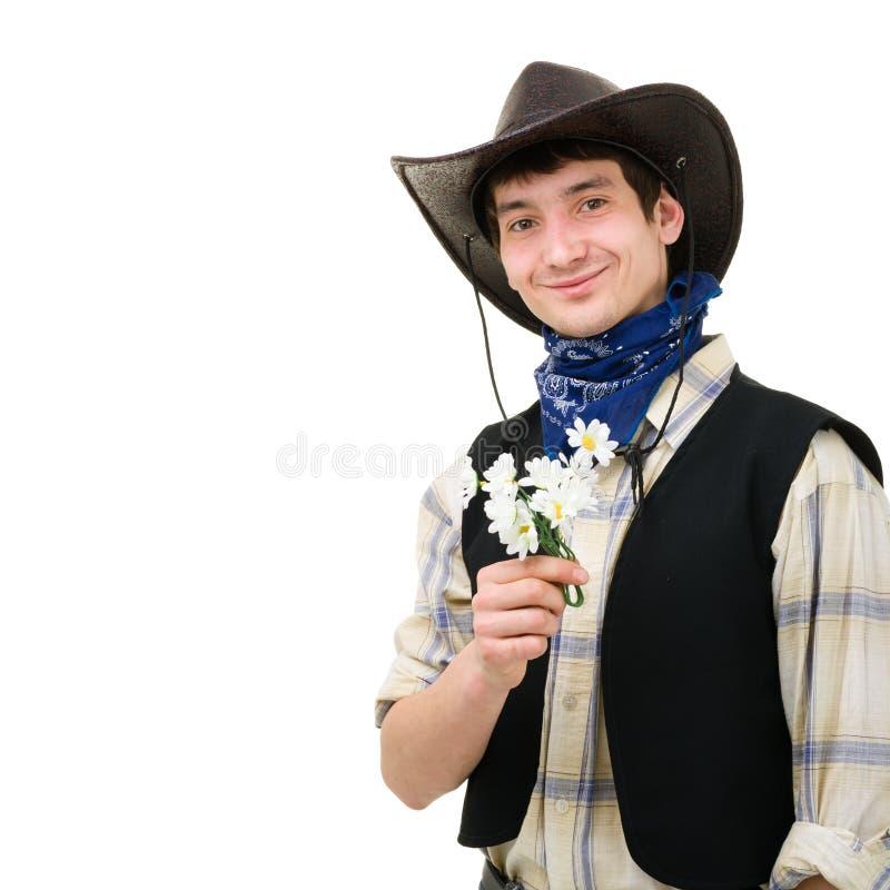 Jeune homme dans un chapeau de cowboy photo libre de droits