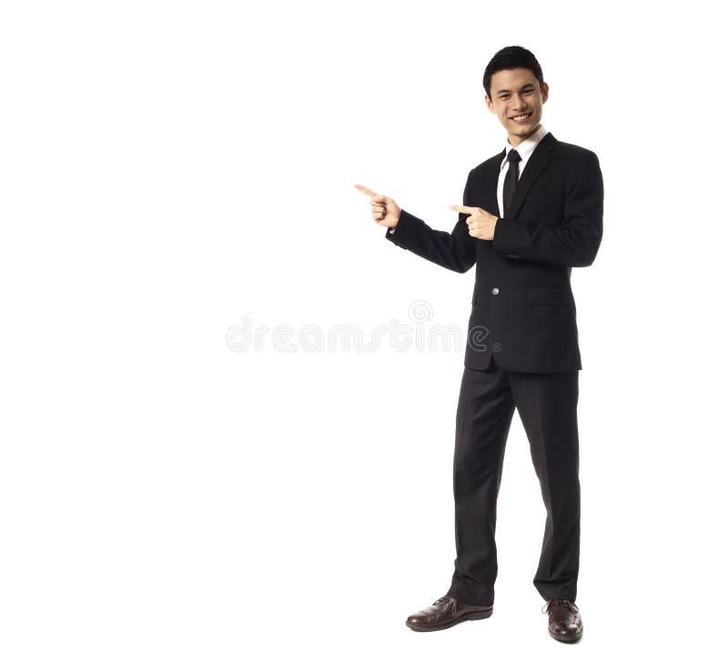 Jeune homme de corporation asiatique dirigeant des doigts de l'esprit deux photos libres de droits
