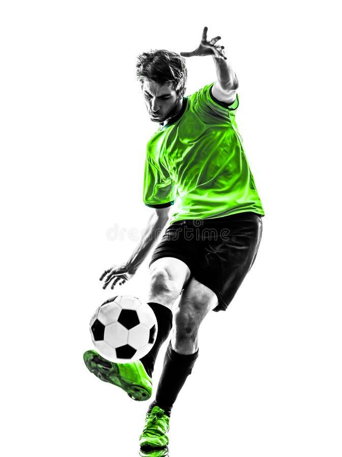 Jeune homme de joueur de football du football donnant un coup de pied la silhouette photos stock