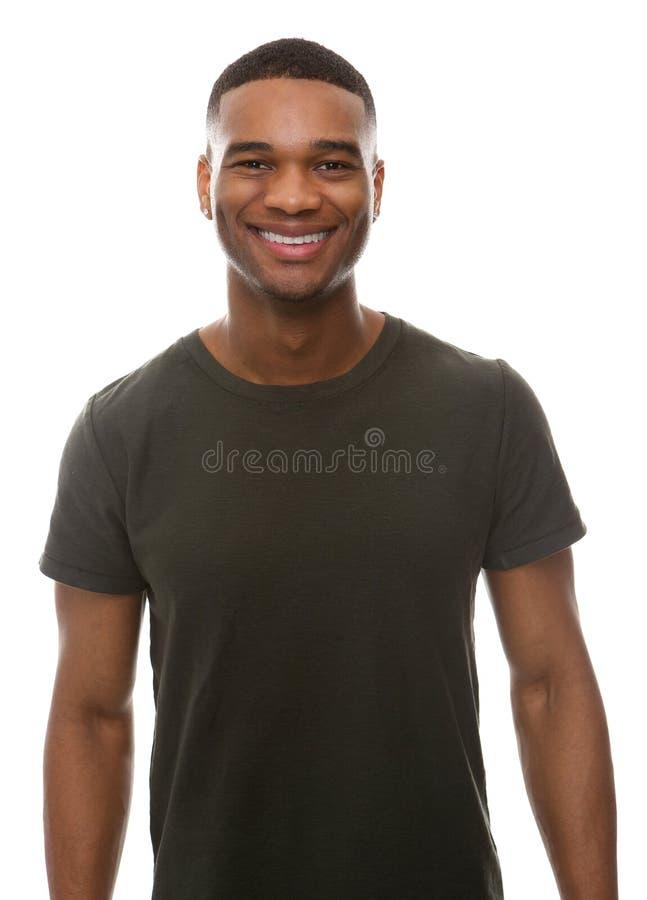 Jeune homme de sourire avec le T-shirt vert photos stock