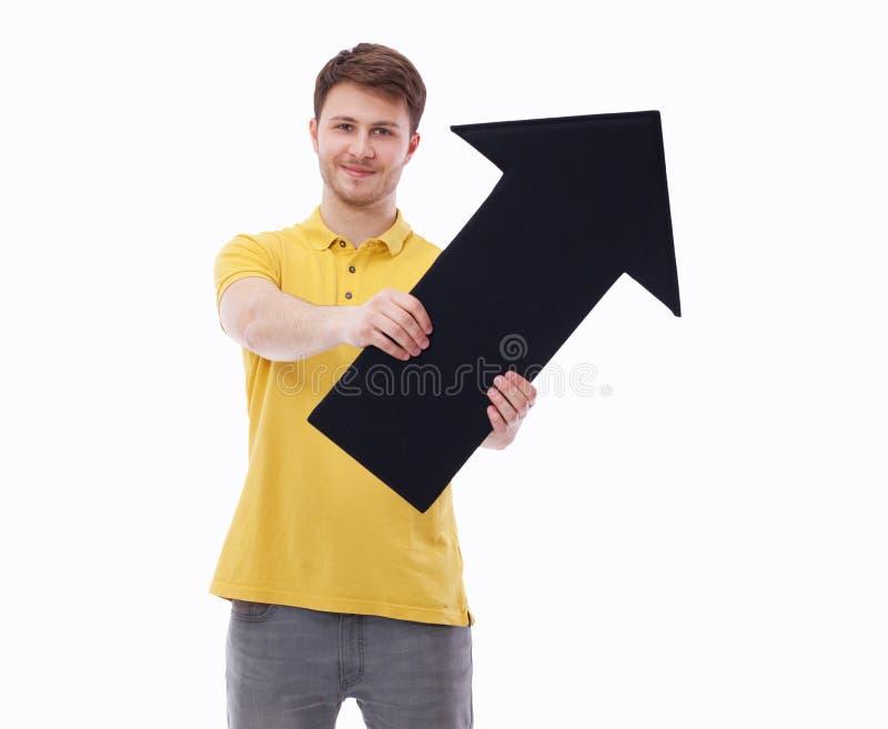 Jeune homme de sourire tenant l'indicateur vide, d'isolement sur le fond blanc photos libres de droits