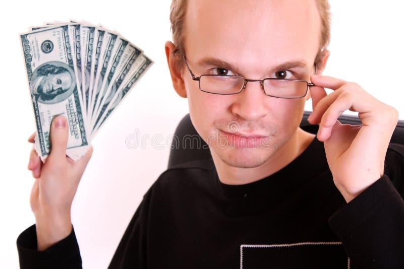 Jeune homme en glaces avec des billets de banque du dollar photo stock
