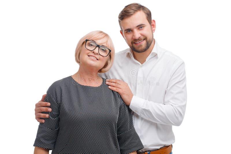Jeune homme et sa femme de professeur sur un fond blanc photographie stock