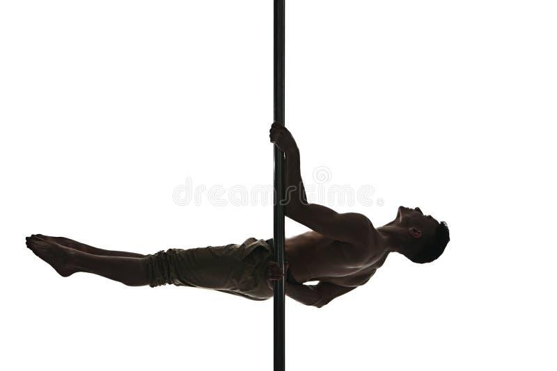 Jeune homme fort de danse de poteau photo libre de droits