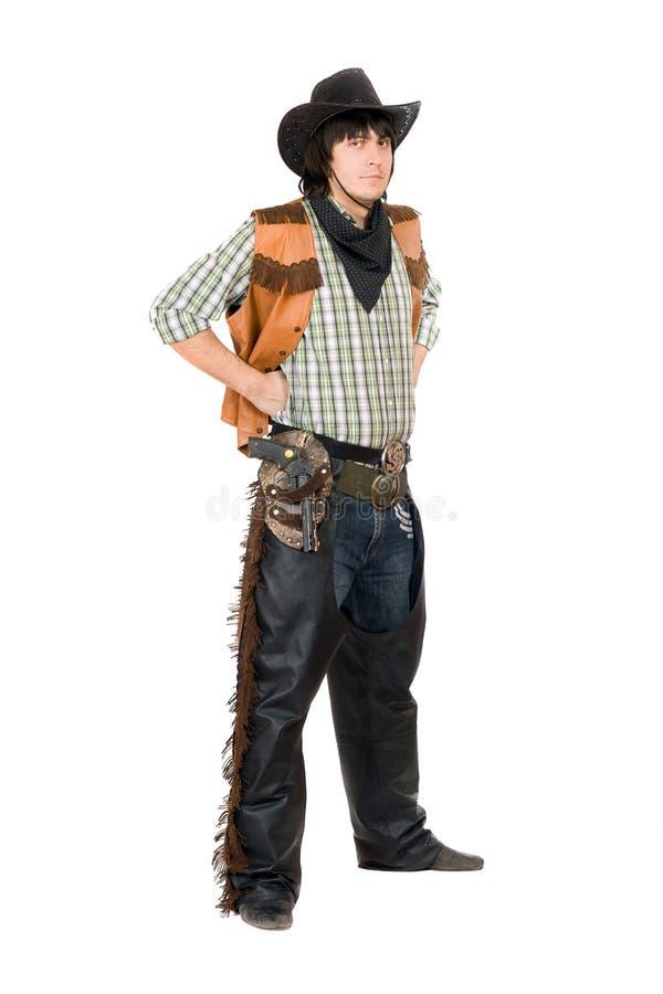 Jeune homme habillé comme cowboy D'isolement photographie stock libre de droits