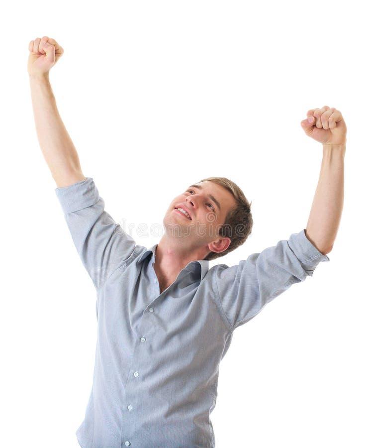 Jeune homme heureux avec des bras vers le haut dans le geste de victoire photographie stock