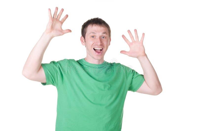 Jeune homme heureux célébrant le succès photo libre de droits
