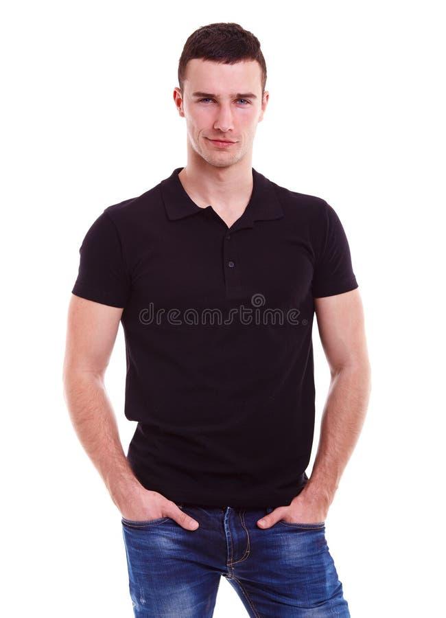 Jeune homme heureux dans un polo noir photos libres de droits