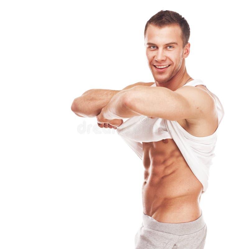 Jeune homme musculaire beau de sports photo stock