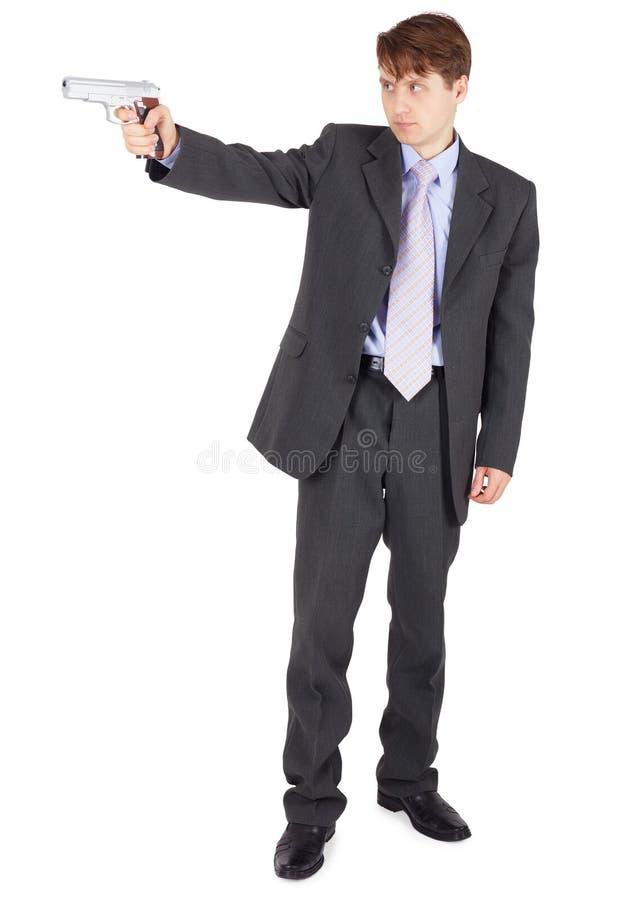 Jeune Homme Orientant Une Arme à Feu Sur Le Fond Blanc Images stock