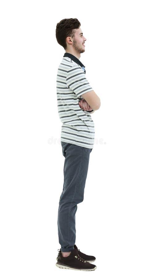 Jeune homme se tenant en longueur d'isolement sur le fond blanc images libres de droits