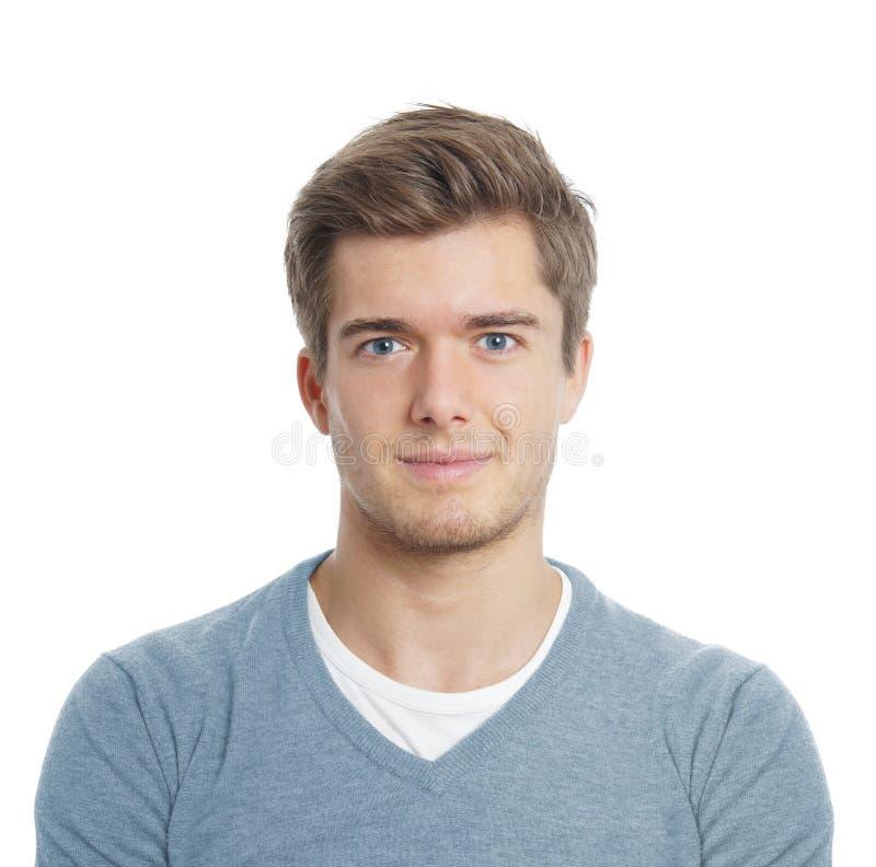 Jeune homme semblant heureux photo stock