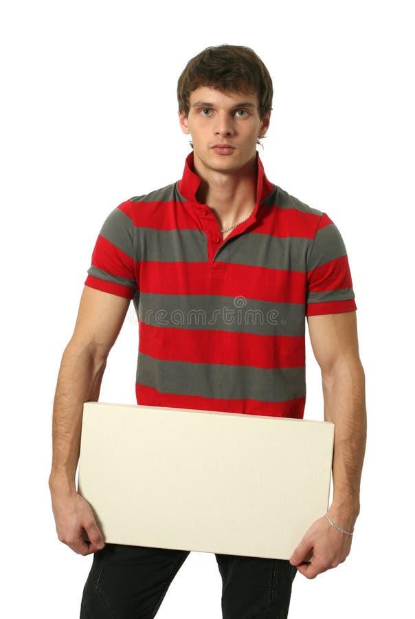 Jeune homme sexy avec le signe de blanc de l'espace de copie photographie stock libre de droits