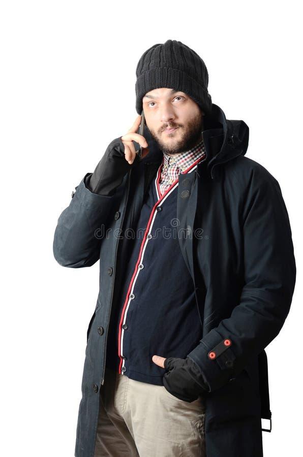 Jeune homme sur le téléphone portable photographie stock